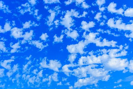 White fluffy clouds in a blue sky Stock Photo