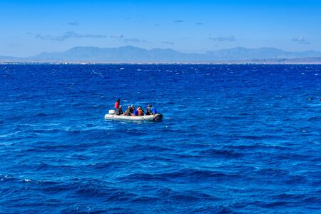 Hurghada, Egypt - December 7, 2018: Inflatable motorboat with tourists in Red sea not far from Hurghada city, Egypt