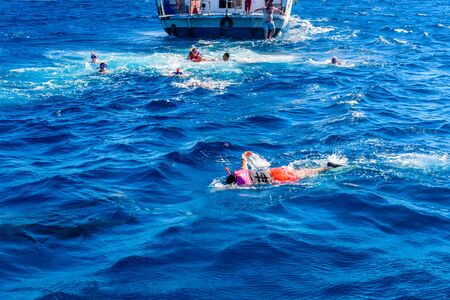 Hurghada, Egypt - December 7, 2018: Group of tourists snorkeling in Red sea. Summer vacation concept Editorial