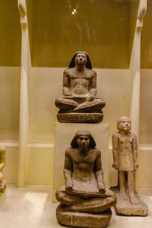 Cairo, Egypt - December 8, 2018: Statuettes in Museum of Egyptian Antiquities (known commonly as the Egyptian Museum or Museum of Cairo)