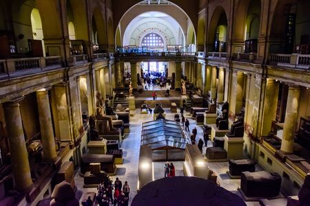 Cairo, Egypt - December 8, 2018: Many tourists in Museum of Egyptian Antiquities (known commonly as the Egyptian Museum or Museum of Cairo)