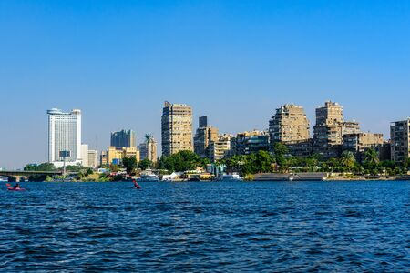 Cairo, Egypt - December 8, 2018: residential and office buildings of Cairo city. View from Nile river Editorial