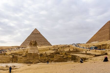 Cairo, Egypt - December 8, 2018: View on great pyramids and Sphinx in Giza plateau. Cairo, Egypt