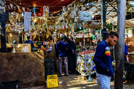 Hurghada, Egypt - December 9, 2018: People at fruit market in Dahar district (old town of Hurghada city), Egypt Editorial