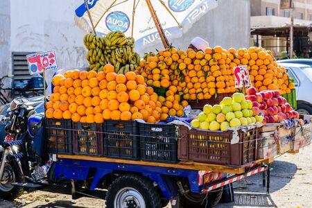Hurghada, Egypt - December 9, 2018: ripe mandarins and orange fruits for sale on fruit market Editorial