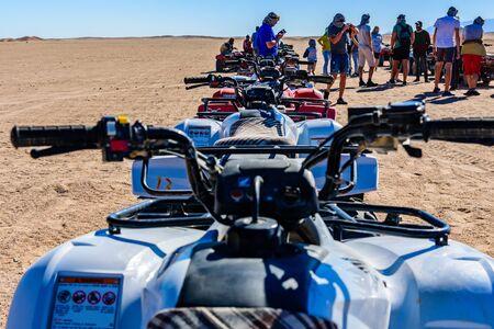 Hurghada, Egypt - December 10, 2018: Unrecognizable people near quad bikes during safari trip in Arabian desert not far from Hurghada city, Egypt Editorial