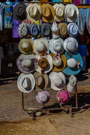 Luxor, Egypt - December 11, 2018: Different hats for sale in street shop Editorial