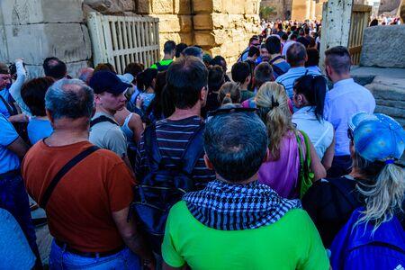 Luxor, Egypt - December 11, 2018: Many tourists in Karnak temple. Luxor, Egypt