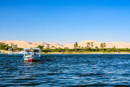 Luxor, Egypt - December 11, 2018: Tourist boat on Nile river in Luxor, Egypt