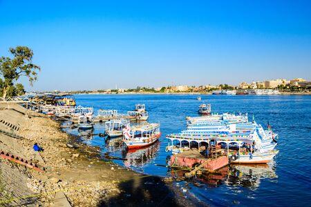 Luxor, Egypt - December 11, 2018: Tourist boats moored near the bank of Nile river in Luxor, Egypt