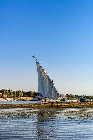 Luxor, Egypt - December 11, 2018: Traditional egyptian vessel felucca on Nile river in Luxor, Egypt