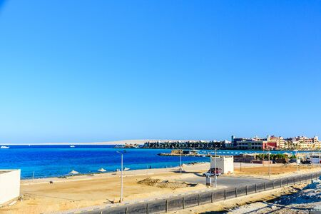 Hurghada, Egypt - December 12, 2018: View on public beach in Hurghada, Egypt. Summer vacation