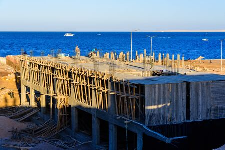 Hurghada, Egypt - December 12, 2018: House construction on bank of Red sea in Hurghada city, Egypt