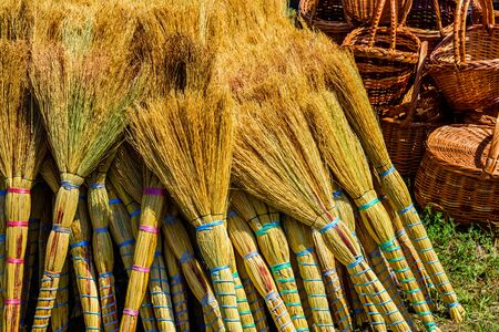 Many brooms for sale on street fair Stock Photo