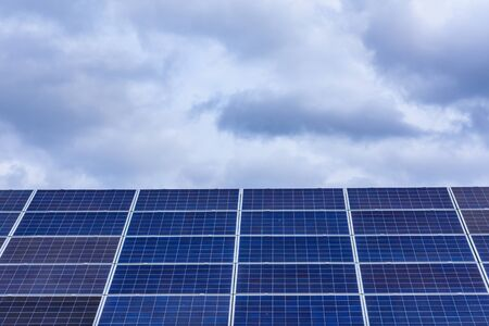 Many solar panels on roof of building Stock Photo