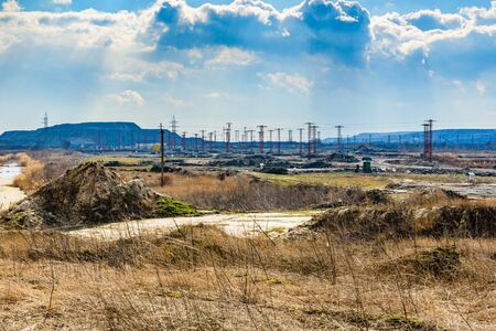 View on electric poles near iron ore quarry