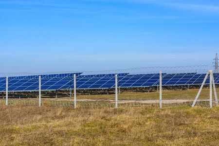 Many solar panels in field. Clean energy. Ecological concept Stock Photo
