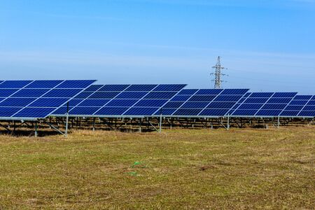Many solar panels in field. Clean energy. Ecological concept