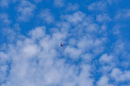 Commercial passenger airplane in a blue sky Stok Fotoğraf
