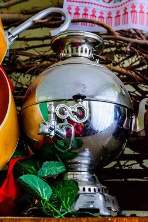Old shiny samovar. Vintage russian home utensil