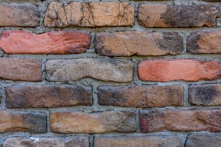 Old wall of red bricks for background