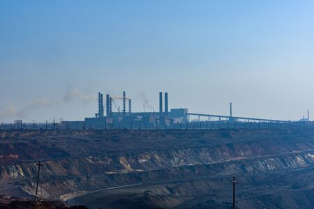 View on iron ore quarry in dust haze
