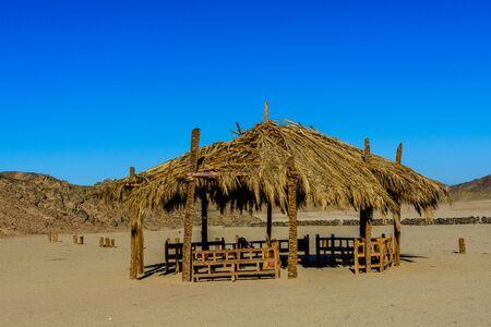 Bedouin building of palm twigs in arabian desert not far from Hurghada city, Egypt