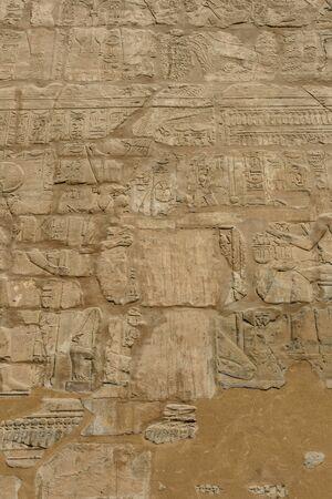 Egyptian ancient hieroglyphs on a stone wall