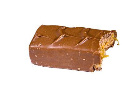 Bitten milk chocolate bar isolated on white background Reklamní fotografie