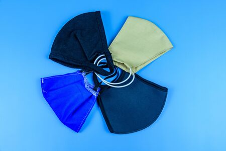 Protective face masks on blue background. Healthcare and medicine concept