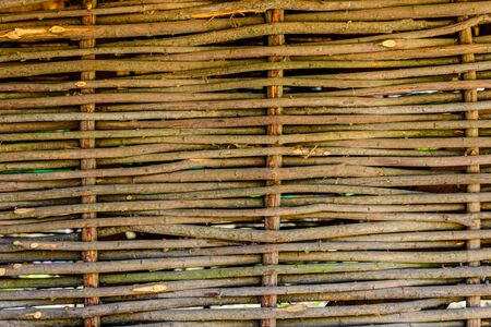Texture of traditional ukrainian wicker fence for background