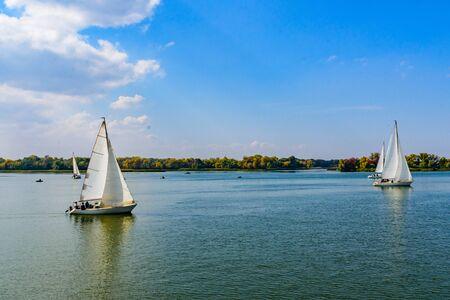 Many yachts at river Dnieper on autumn in Kremenchug, Ukraine. Sailing regatta Reklamní fotografie