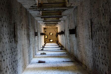 Abandoned elevator shaft in old multi story building
