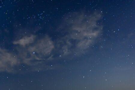 Background of night sky with many stars and clouds Reklamní fotografie
