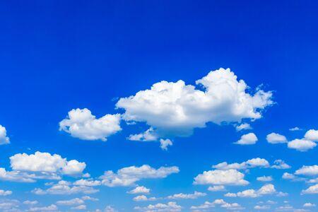 White fluffy clouds in a blue sky Reklamní fotografie