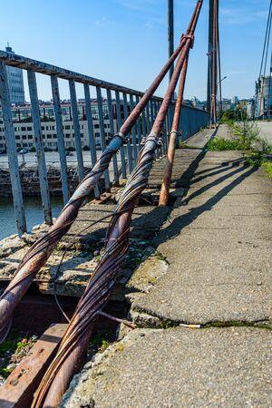 Old rusty steel rope of bridge. Closeup