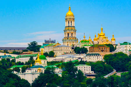 View on buildings of Kiev Pechersk Lavra and Great bell tower from left bank of river Dnieper in Kiev, Ukraine 免版税图像
