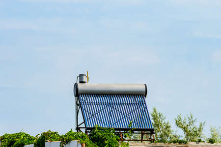 Solar water heater on roof of residential house. Clean energy. Ecological concept
