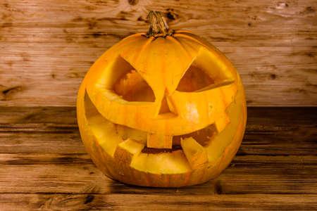 Spooky halloween pumpkin on rustic wooden table