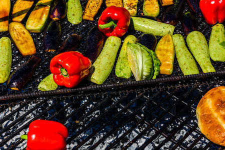 Different vegetables cooking on grill at country fair