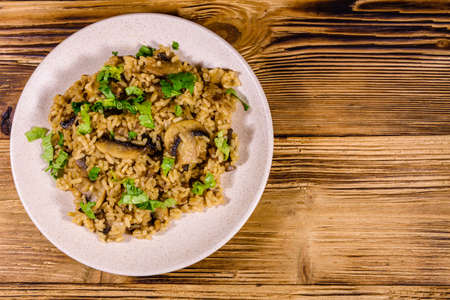Risotto with mushrooms and parsley in plate. Top view Archivio Fotografico