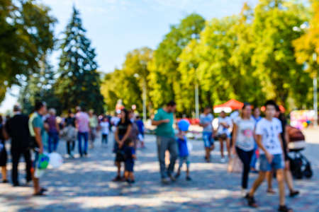 Abstract blurred background of people in city park