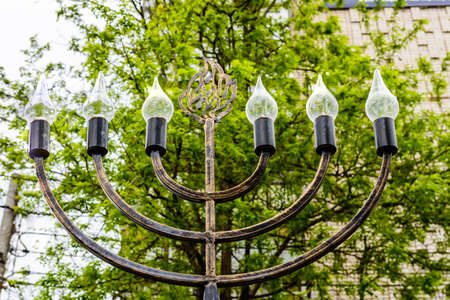 City lantern in shape of jewish candlestick menorah
