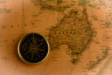 Compass on old map of world. Journey and discovery concept 写真素材