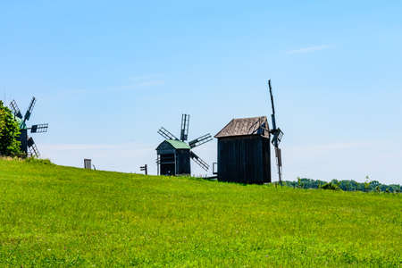 Old rustic wooden wind mill in Pyrohiv, Ukraine