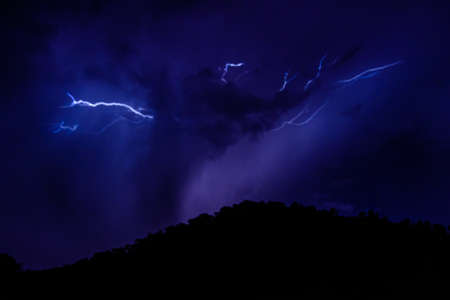 Lightning in night sky during the thunderstorm Stock Photo