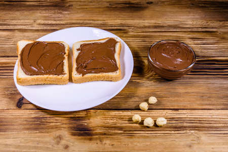 Two sandwiches with chocolate spread on white plate Banco de Imagens