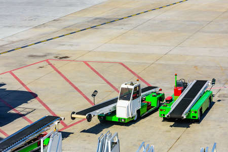 Vehicle for loading luggage in airplane at airport in Antalya city, Turkey