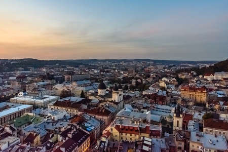 View on historic center of Lviv at sunset. View on Lvov cityscape from the town hall Editorial