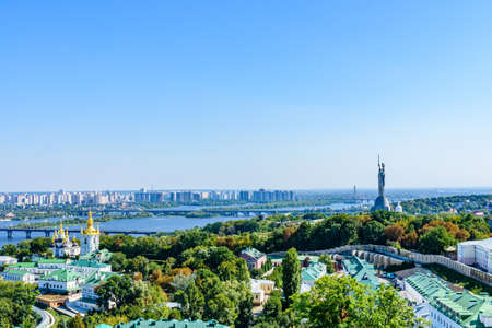 View on Church of Nativity of Blessed Virgin Mary of Kiev Pechersk Lavra, river Dnieper, Kiev cityscape and monument of Mother Motherland Imagens